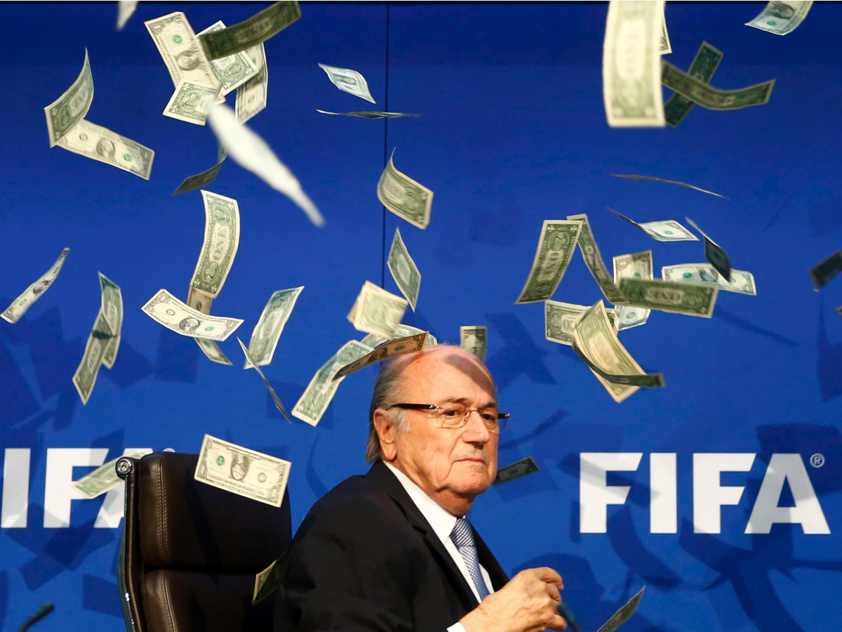 a-comedian-threw-money-at-fifa-president-sepp-blatter-during-a-news-conference.jpg