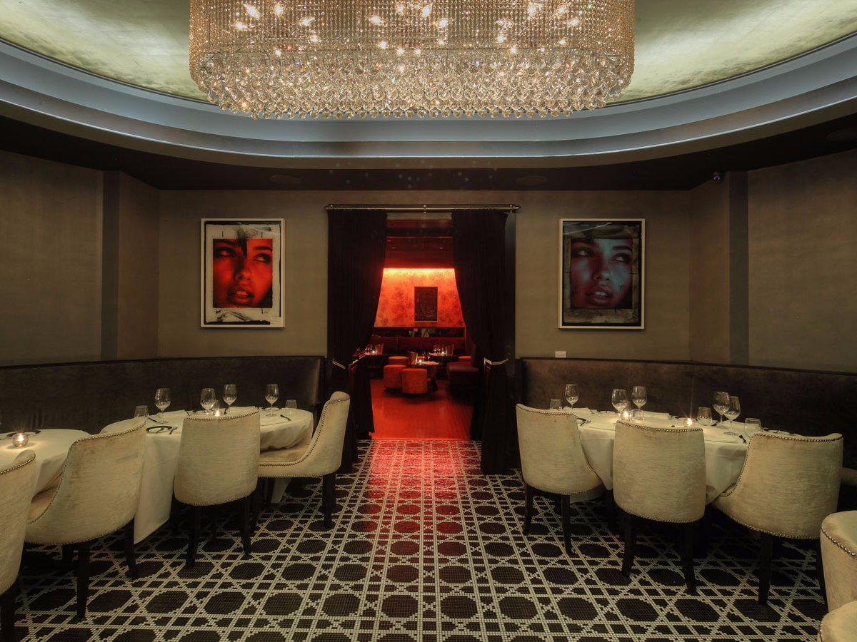 bakhshi-spared-no-expense-for-the-central-dining-room-pictured-below-which-is-adorned-in-jean-paul-gaultier-fabrics-a-gold-leaf-ceiling-bisazza-tiles-and-custom-chandeliers-whats-nice-about-the-back-room-is-that-you-can