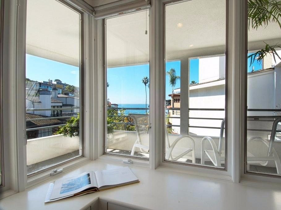 there-are-plenty-of-wide-open-windows-to-enjoy-the-views-throughout-the-home