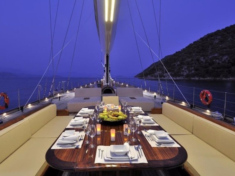 a-table-on-the-deck-also-has-room-for-all-the-guests-on-board