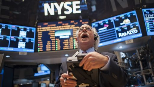 epa03611361 A trader works on the floor of the New York Stock Exchange at the Closing Bell in New York, New York, USA, 05 March 2013. The market closed with a record high of 14.253.77.  EPA/KEITH BEDFORD