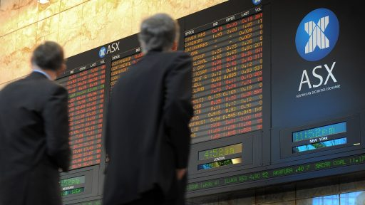 Two men walk past the Australian Stock Exchange