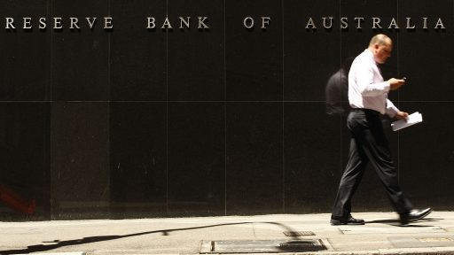 SYDNEY, AUSTRALIA - FEBRUARY 03: A Pedestrian walk past the Reserve Bank of Australia as economists wait to see if The Reserve Bank of Australia cut official interest rates today, at the RBA on February 3, 2009 in Sydney, Australia. The RBA are expected to cut rates by up to 1 percent this afternoon, taking rates down to 3.25 per cent, with further cuts already being discussed for next month. The rate cut would put pressure on the top four Australian banks to follow suit and cut their rates on the back of recently announced huge profits, to rates not seen in Australia since the 1964. (Photo by Brendon Thorne/Getty Images)